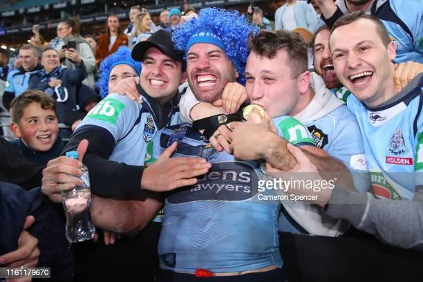 James Tedesco of the Blues poses with fans after winning game three of the 2019 State of Origin series between the New South Wales Blues and the...