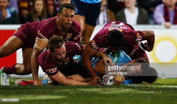 James Tedesco of the Blues scores a try during game one of the State Of Origin series between the Queensland Maroons and the New South Wales Blues at...