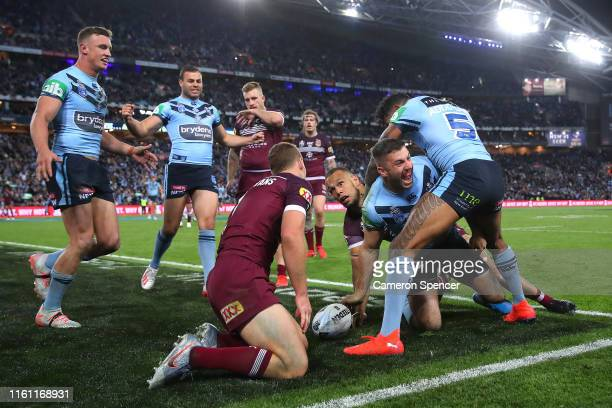 James Tedesco of the Blues scores a try during game three of the 2019 State of Origin series between the New South Wales Blues and the Queensland...