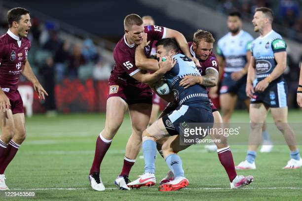 James Tedesco of the NSW Blues is tackled during game one of the 2020 State of Origin series between the Queensland Maroons and New South Wales Blues...