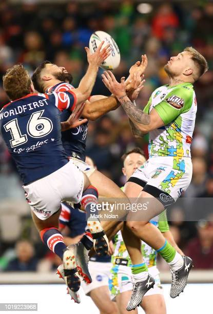 James Tedesco of the Roosters and Blake Austin of the Raiders contest a high ball during the round 23 NRL match between the Canberra Raiders and the...