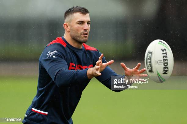 James Tedesco of the Roosters catches a ball during a Sydney Roosters NRL training session at Kippax Lake on March 16, 2020 in Sydney, Australia.