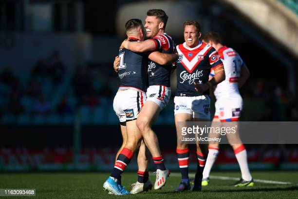 James Tedesco of the Roosters celebrates with Angus Crichton of the Roosters after scoring a try during the round 18 NRL match between the Sydney...