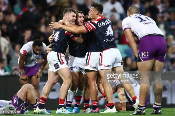 James Tedesco of the Roosters celebrates with team mates after scoring a try during the NRL Preliminary Final match between the Sydney Roosters and...