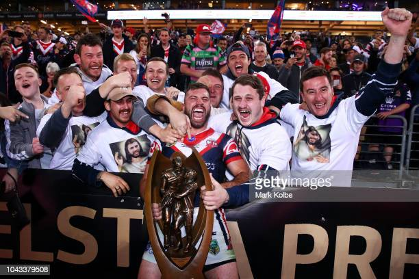 James Tedesco of the Roosters celebrates with the crowd as he holds the ProvanSummons Trophy during the 2018 NRL Grand Final match between the...