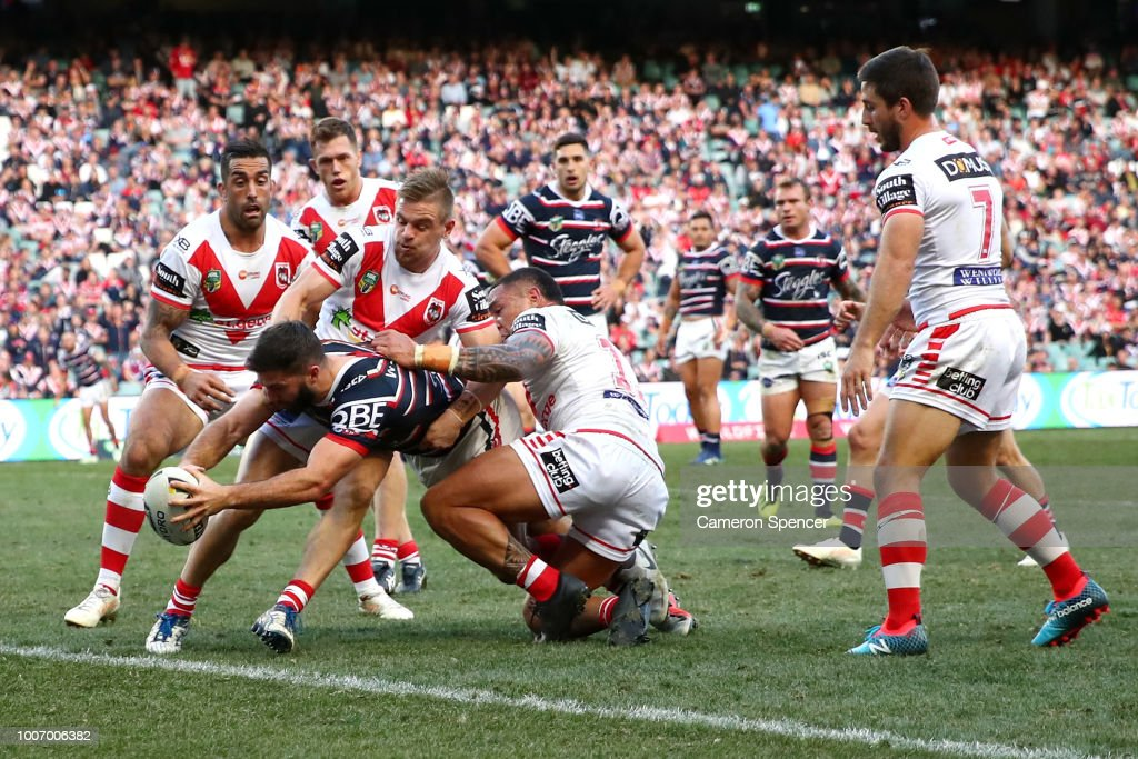 James Tedesco of the Roosters is held up short as he attempts to score a try during the round 20 NRL match between the Sydney Roosters and the St George Illawarra Dragons at Allianz Stadium on July 29, 2018 in Sydney, Australia.