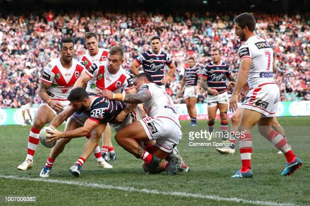 James Tedesco of the Roosters is held up short as he attempts to score a try during the round 20 NRL match between the Sydney Roosters and the St...
