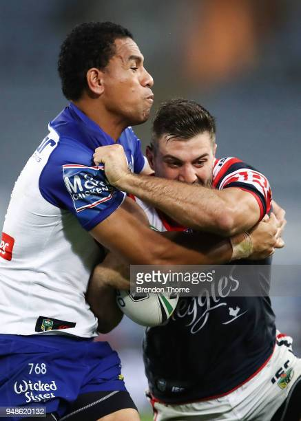 James Tedesco of the Roosters is tackled by Moses Mbye of the Bulldogs during the round seven NRL match between the Canterbury Bulldogs and the...