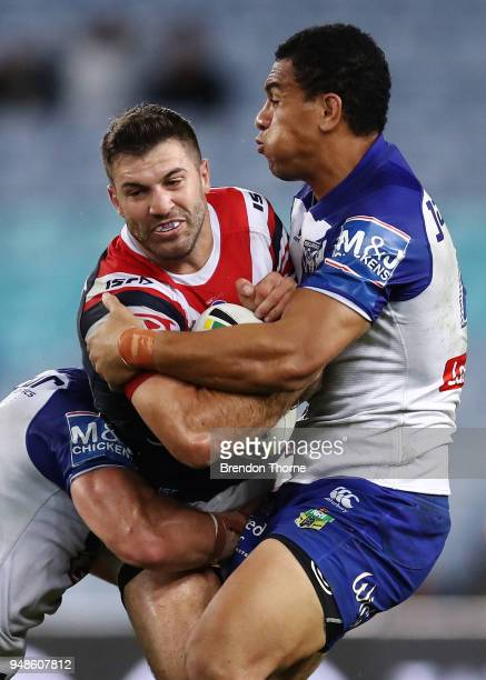James Tedesco of the Roosters is tackled by the Bulldogs defence during the round seven NRL match between the Canterbury Bulldogs and the Sydney...
