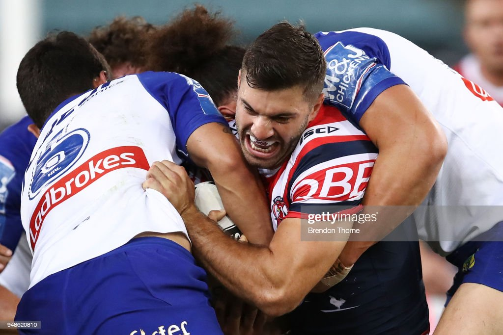 James Tedesco of the Roosters is tackled by the Bulldogs defence during the round seven NRL match between the Canterbury Bulldogs and the Sydney Roosters at ANZ Stadium on April 19, 2018 in Sydney, Australia.