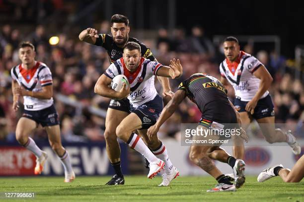 James Tedesco of the Roosters is tackled during the NRL Qualifying Final match between the Penrith Panthers and the Sydney Roosters at Panthers...