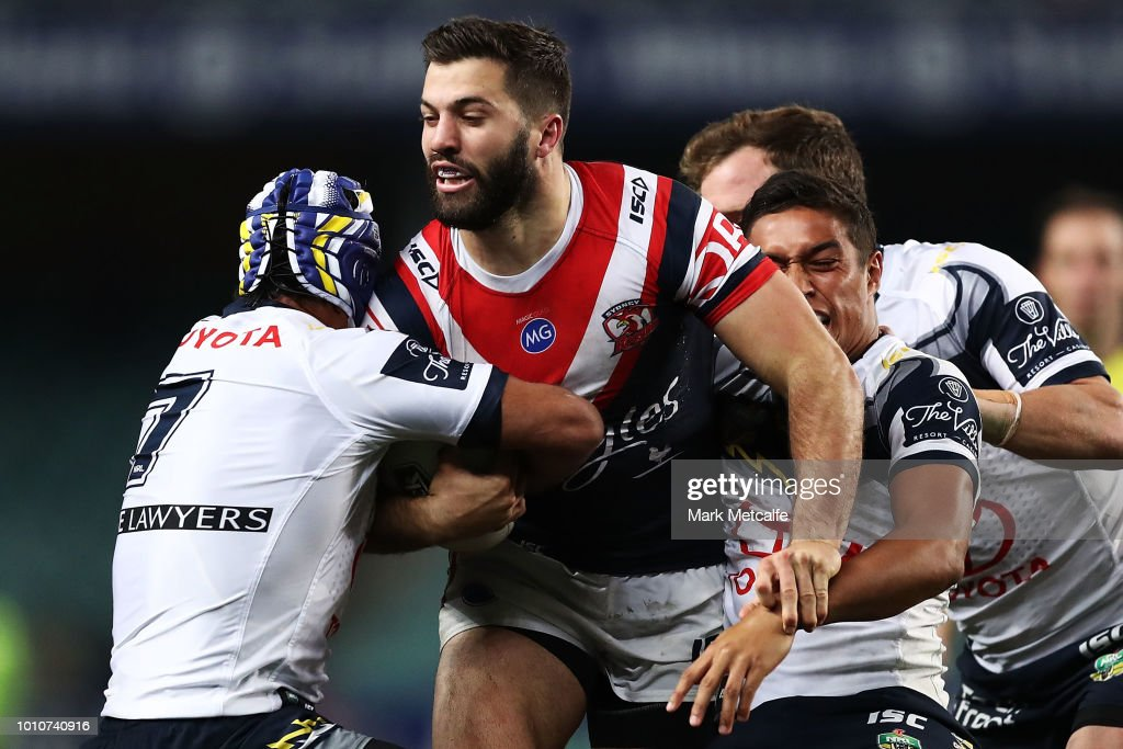 James Tedesco of the Roosters is tackled during the round 21 NRL match between the Sydney Roosters and the North Queensland Cowboys at Allianz Stadium on August 4, 2018 in Sydney, Australia.
