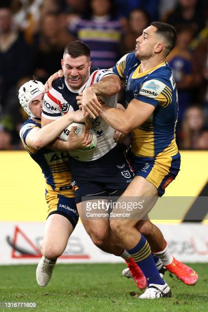 James Tedesco of the Roosters is tackled during the round nine NRL match between the Parramatta Eels and the Sydney Roosters at Bankwest Stadium on...