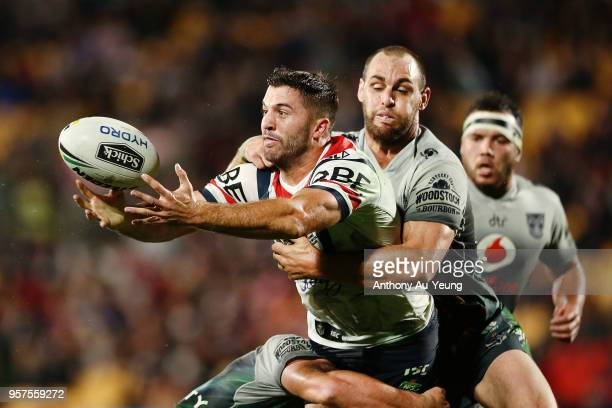 James Tedesco of the Roosters is tackled Simon Mannering of the Warriors during the round 10 NRL match between the New Zealand Warriors and the...
