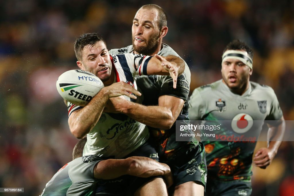 James Tedesco of the Roosters is tackled Simon Mannering of the Warriors during the round 10 NRL match between the New Zealand Warriors and the Sydney Roosters at Mt Smart Stadium on May 12, 2018 in Auckland, New Zealand.