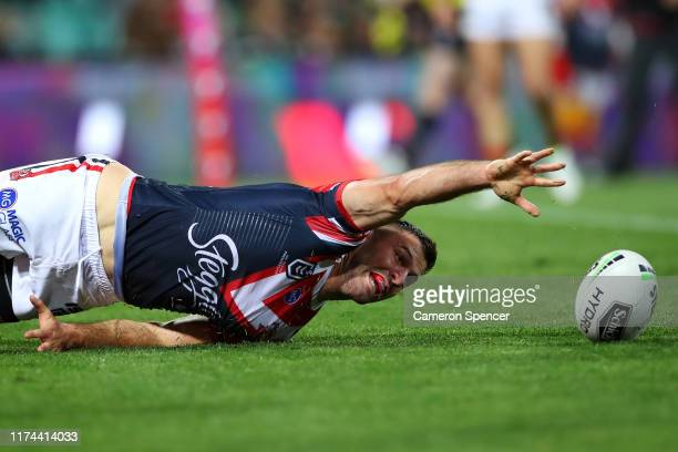 James Tedesco of the Roosters reaches for the ball in goal during the NRL Qualifying Final match between the Sydney Roosters and the South Sydney...