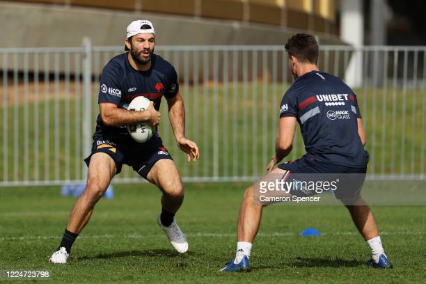 James Tedesco of the Roosters runs the ball during a Sydney Roosters NRL training session at Kippax Lake Field on May 14, 2020 in Sydney, Australia.