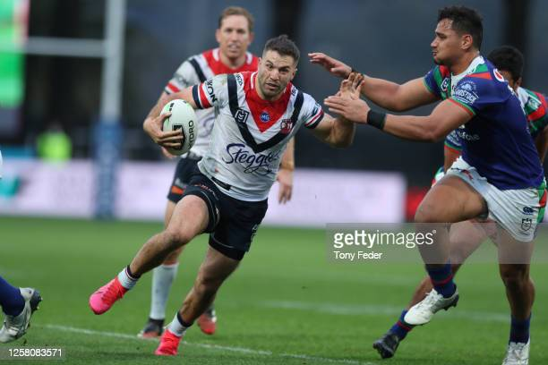 James Tedesco of the Roosters runs the ball during the round 11 NRL match between the New Zealand Warriors and the Sydney Roosters at Central Coast...