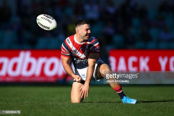 James Tedesco of the Roosters scores a try during the round 18 NRL match between the Sydney Roosters and the Newcastle Knights at Sydney Cricket...