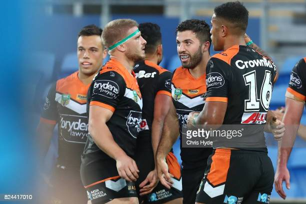 James Tedesco of the Tigers celebrates a try with team mates during the round 21 NRL match between the Gold Coast Titans and the Wests Tigers at Cbus...