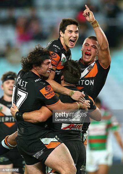 James Tedesco of the Tigers celebrates scoring a try with team mates during the round 14 NRL match between the Wests Tigers and the South Sydney...