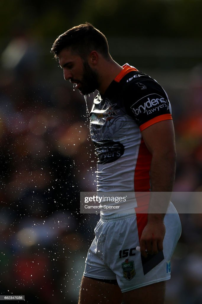 James Tedesco of the Tigers cools down during the round two NRL match between the Wests Tigers and the Penrith Panthers at Campbelltown Sports Stadium on March 12, 2017 in Sydney, Australia.