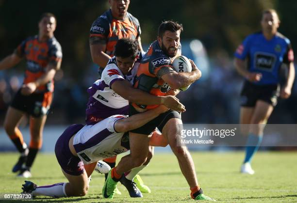 James Tedesco of the Tigers is tackled during the round four NRL match between the Wests Tigers and the Melbourne Storm at Leichhardt Oval on March...