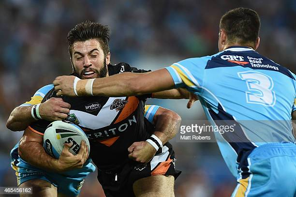 James Tedesco of the Tigers is tackled during the round one NRL match between the Gold Coast Titans and the Wests Tigers at Cbus Super Stadium on...