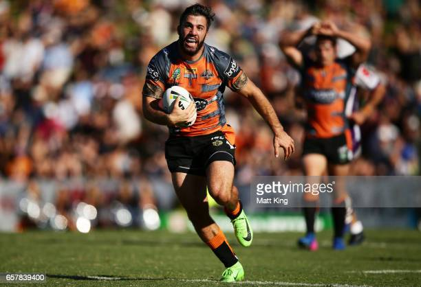 James Tedesco of the Tigers makes a break during the round four NRL match between the Wests Tigers and the Melbourne Storm at Leichhardt Oval on...
