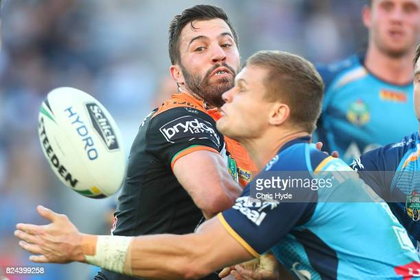James Tedesco of the Tigers passes during the round 21 NRL match between the Gold Coast Titans and the Wests Tigers at Cbus Super Stadium on July 30...