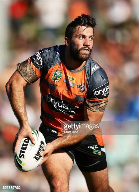 James Tedesco of the Tigers passes during the round four NRL match between the Wests Tigers and the Melbourne Storm at Leichhardt Oval on March 26...
