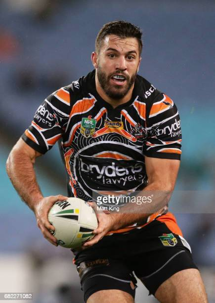 James Tedesco of the Tigers runs with the ball during the round ten NRL match between the Wests Tigers and the South Sydney Rabbitohs at ANZ Stadium...