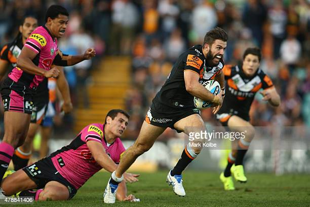 James Tedesco of the Wests Tigers makes a break during the round 16 NRL match between the Wests Tigers and the Penrith Panthers at Leichhardt Oval on...