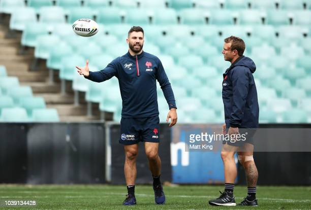 James Tedesco talks to Jake Friend during a Sydney Roosters NRL training session at Allianz Stadium on September 24 2018 in Sydney Australia