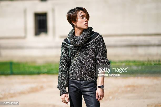 James Teeradon Supapunpinyo wears a black flecked sweater black leather pants outside the Chanel Cruise Collection 2020 At Grand Palais on May 03...
