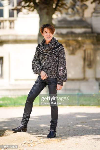 James Teeradon Supapunpinyo wears a black flecked sweater black leather pants Chanel black boots outside the Chanel Cruise Collection 2020 At Grand...