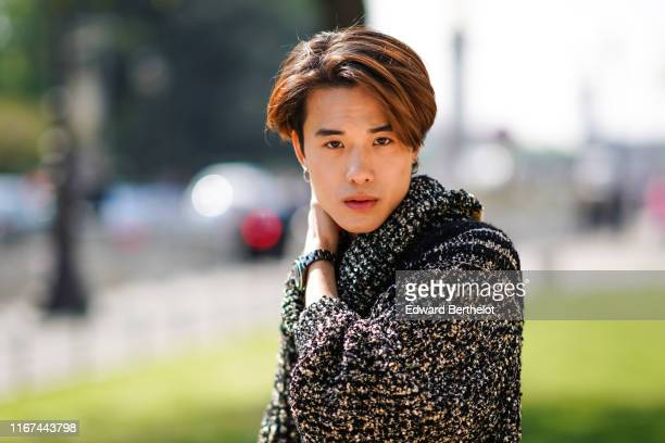 James Teeradon Supapunpinyo wears a black flecked sweater outside the Chanel Cruise Collection 2020 At Grand Palais on May 03 2019 in Paris France
