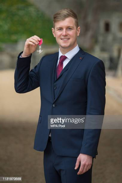James Threlfall with his MBE medal awarded by Queen Elizabeth II at an investiture ceremony at Windsor Castle on March 22 2019 in Windsor England