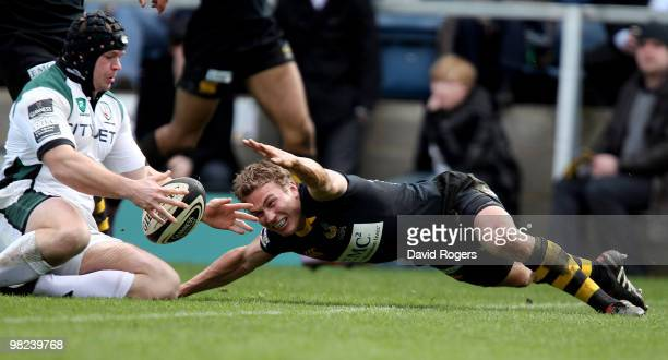 James Tideswell of London Irish beats Warrren Fury to the ball to score a try during the Guinness Premiership match between London Wasps and London...