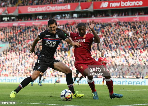 James Tomkins of Crystal Palace and Georginio Wijnaldum of Liverpool battle for possession during the Premier League match between Liverpool and...
