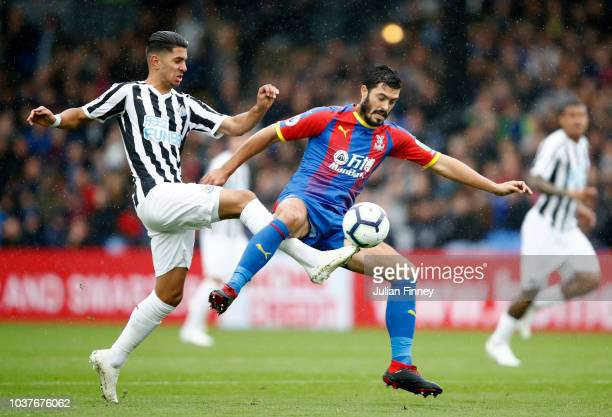 James Tomkins of Crystal Palace battles for possession with Ayoze Perez of Newcastle United during the Premier League match between Crystal Palace...
