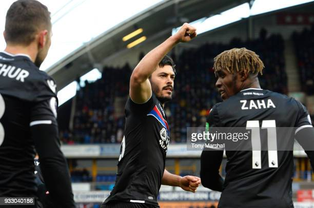 James Tomkins of Crystal Palace celebrates scoring his side's first goal with Wilfried Zaha during the Premier League match between Huddersfield Town...