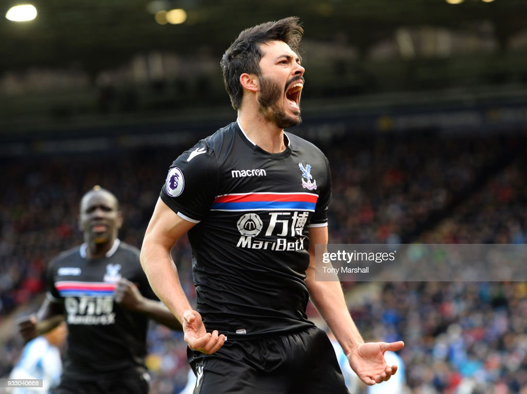 James Tomkins of Crystal Palace celebrates scoring his side's first goal during the Premier League match between Huddersfield Town and Crystal Palace at John Smith's Stadium on March 17, 2018 in Huddersfield, England.