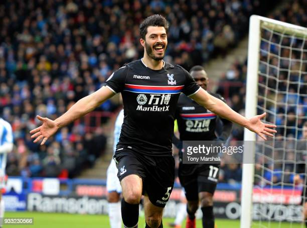 James Tomkins of Crystal Palace celebrates scoring their first goal during the Premier League match between Huddersfield Town and Crystal Palace at...