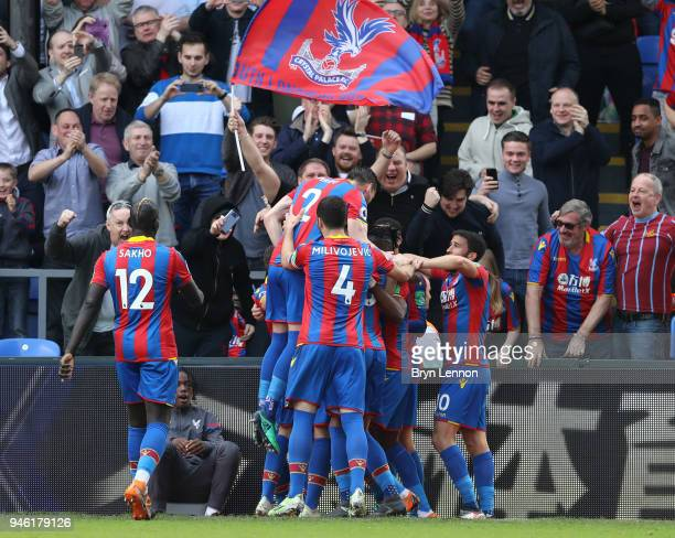 James Tomkins of Crystal Palace celebrates with teammates after scoring his sides second goal during the Premier League match between Crystal Palace...