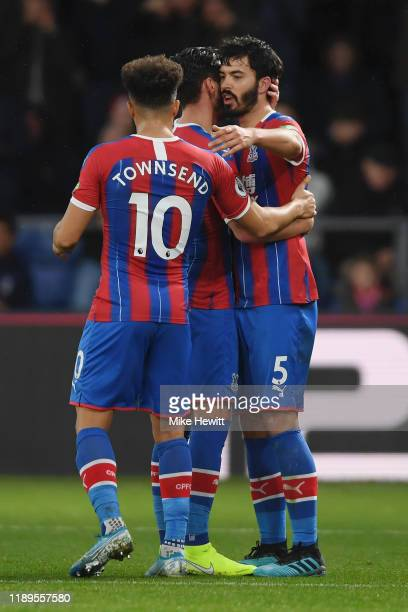 James Tomkins of Crystal Palace celebrates with teammates after scoring which is later disallowed by VAR during the Premier League match between...