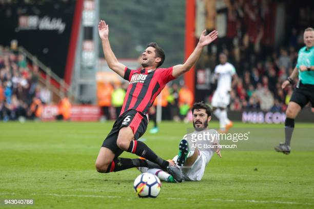 James Tomkins of Crystal Palace fouls Andrew Surman of Bournemouth and is booked during the Premier League match between AFC Bournemouth and Crystal...