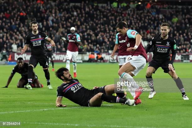 James Tomkins of Crystal Palace fouls Javier Hernandez of West Ham resulting in a penalty during the Premier League match between West Ham United and...