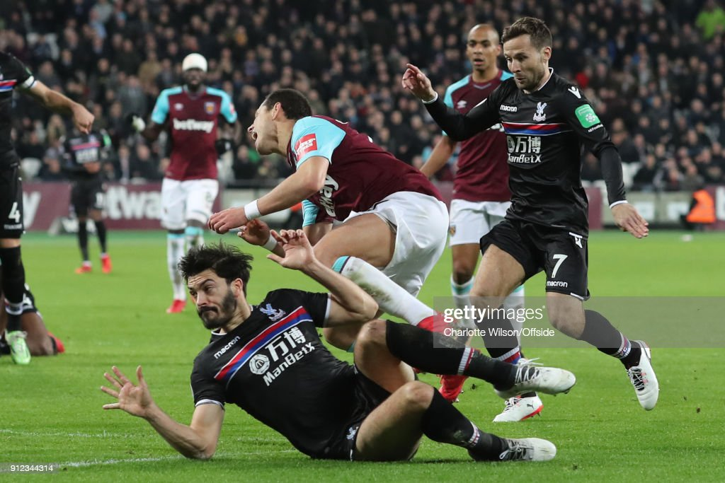 James Tomkins of Crystal Palace fouls Javier Hernandez of West Ham resulting in a penalty during the Premier League match between West Ham United and Crystal Palace at London Stadium on January 30, 2018 in London, England.