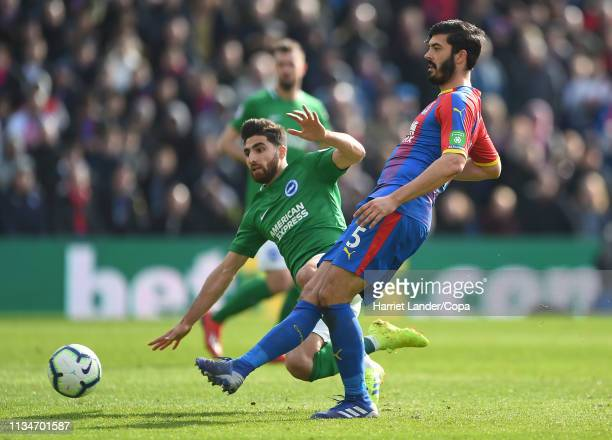 James Tomkins of Crystal Palace is challenged by Alireza Jahanbakhsh of Brighton Hove Albion during the Premier League match between Crystal Palace...